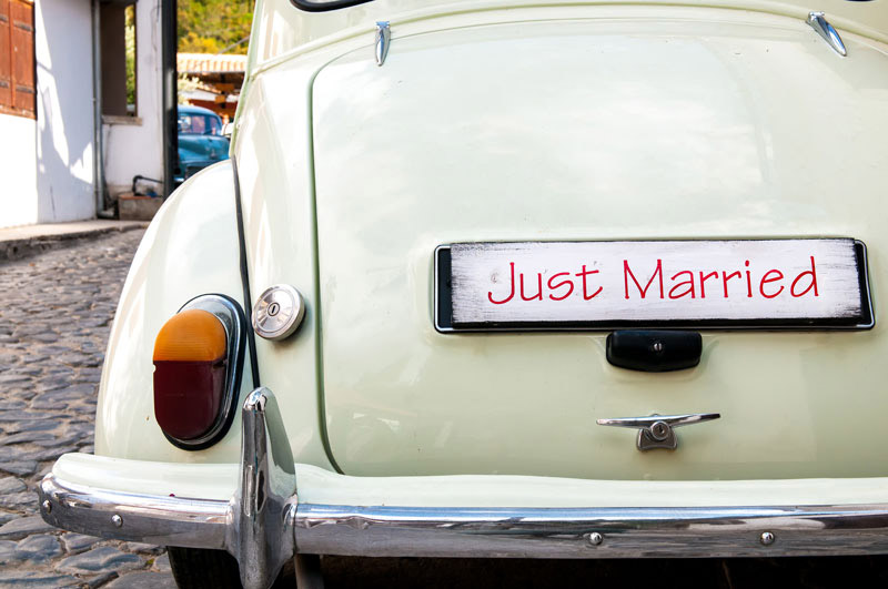 Should Newlyweds Combine Their Auto Insurance Policies?