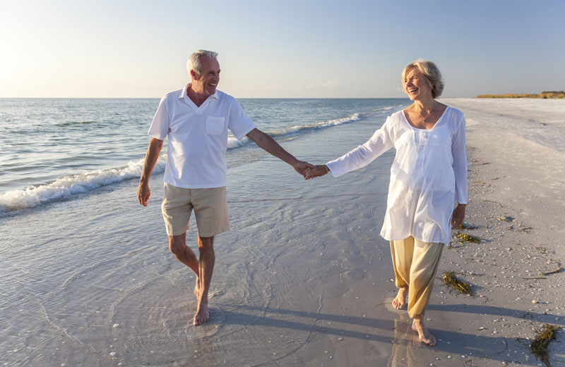 retired couple on a beach
