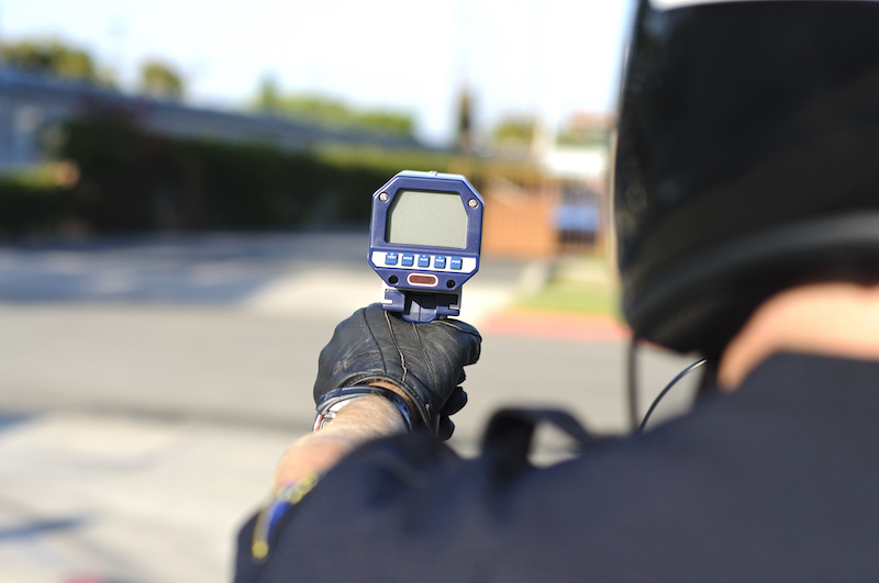 policeman holding speeding test