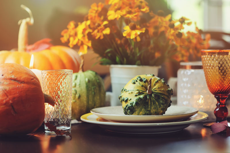 an autumnal table with pumpkins